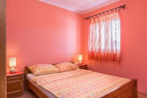 A bed or beds in a room at Apartments Villa Orange