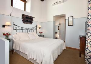 سرير أو أسرّة في غرفة في La Morada Mas Hermosa