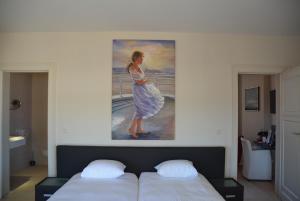 Een bed of bedden in een kamer bij Hotel Villa Anita