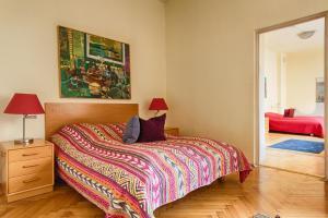 Łóżko lub łóżka w pokoju w obiekcie Nordic House Apartments