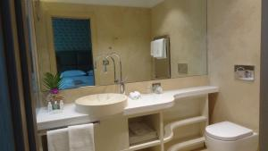 A bathroom at Augustana House and Suites