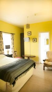 A bed or beds in a room at The Orchard Bed and Breakfast