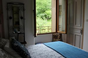 A bed or beds in a room at El Camino De Najac