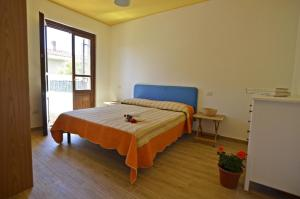 Letto o letti in una camera di Casa Vacanza Via Sulcis