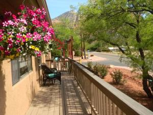 A balcony or terrace at Whispering Creek Bed & Breakfast