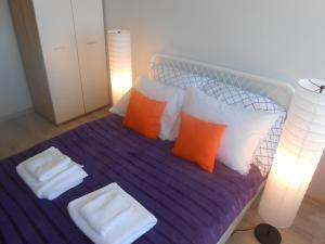 Ein Bett oder Betten in einem Zimmer der Unterkunft Apartament Arkońska