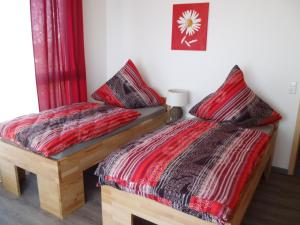 A bed or beds in a room at Pension Rammert