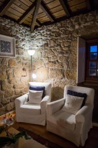 A bed or beds in a room at Casa da Ferreirinha