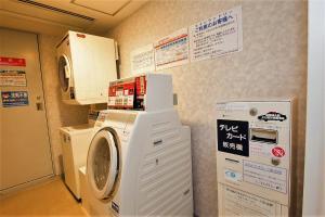 A kitchen or kitchenette at ibis Styles Osaka Namba