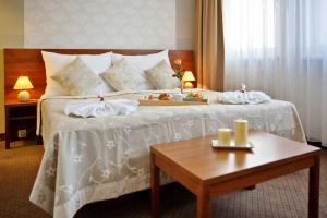 Posteľ alebo postele v izbe v ubytovaní Hotel Janosik