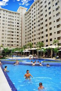 The swimming pool at or near Prive Boulevard Suite Hotel