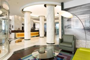 The lobby or reception area at Best Western Plus Hotel Universo