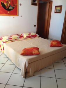 A bed or beds in a room at Appartamento Vacanze A Palermo