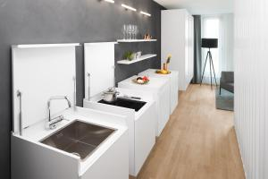 A kitchen or kitchenette at AMANO HOME Apartments