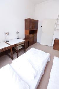 A bed or beds in a room at Hostel Hlávkova