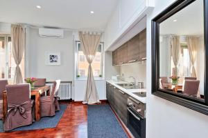 Cuisine ou kitchenette dans l'établissement Residenza dell'Olmata - My Extra Home