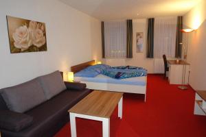 Ein Bett oder Betten in einem Zimmer der Unterkunft Hotel Garni Daniela Urich