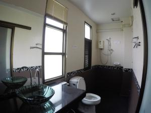 Ванная комната в The Old Palace Resort Klong Sa Bua