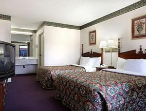 A bed or beds in a room at Days Inn by Wyndham Dillon