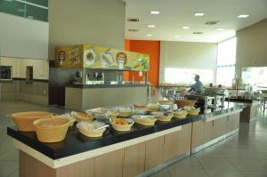 A restaurant or other place to eat at Riviera Park - Flat Residencial