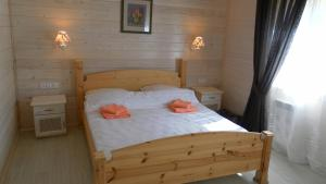 Кровать или кровати в номере Гостевой Дом на Горе Левитана