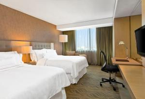 A bed or beds in a room at The Westin Guadalajara