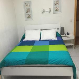 Cama o camas de una habitación en Hostal Tres Cantos