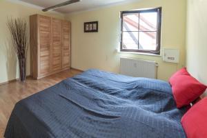 Ein Bett oder Betten in einem Zimmer der Unterkunft Ferienwohnung Reislöhner