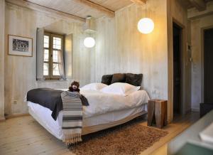 Ένα ή περισσότερα κρεβάτια σε δωμάτιο στο Mikro Papigo 1700 Hotel & Spa