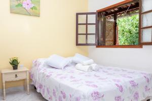 Cama ou camas em um quarto em Pousada Sossego