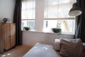 A bed or beds in a room at Vakantiehuis Zandvoort
