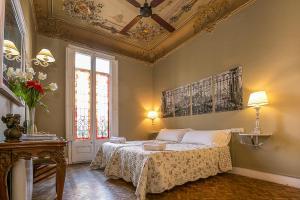A bed or beds in a room at Casa del Mediterraneo