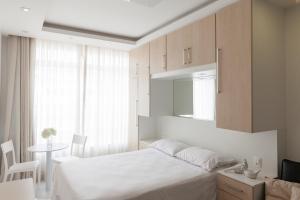 Cama ou camas em um quarto em Zanzicopa Copacabana