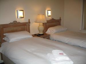 A bed or beds in a room at The Barrington Hotel