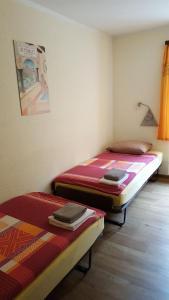 Ein Bett oder Betten in einem Zimmer der Unterkunft Hotel Stille