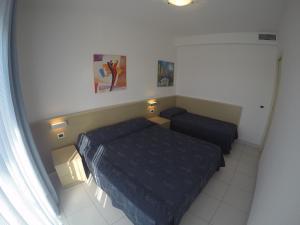 Postel nebo postele na pokoji v ubytování Residence Zenith