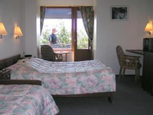 Ein Bett oder Betten in einem Zimmer der Unterkunft Hotel Perekop