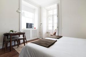Een bed of bedden in een kamer bij bnapartments Carregal