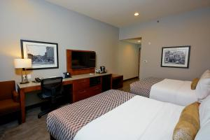 A bed or beds in a room at Best Western Plus East Side