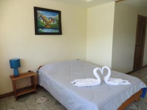 Cama o camas de una habitación en Cabinas Nuestra Kasa