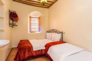 Ein Bett oder Betten in einem Zimmer der Unterkunft Hotel Atlas