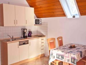 Küche/Küchenzeile in der Unterkunft Vogtadeshof