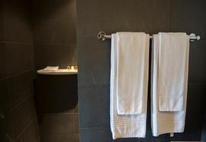 Ein Badezimmer in der Unterkunft Auberge de la Croix Blanche