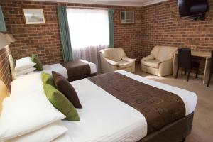 A bed or beds in a room at A Line Motel