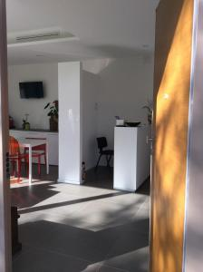Телевизор и/или развлекательный центр в La Veranda Sul Giardino