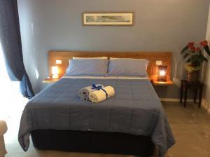 Кровать или кровати в номере La Veranda Sul Giardino
