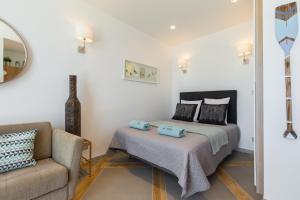 A bed or beds in a room at La Maison Du Pêcheur