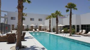 The swimming pool at or near The Palace Boutique Hotel