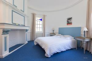 Un ou plusieurs lits dans un hébergement de l'établissement Auberge du Manoir d'Archelles