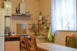 A kitchen or kitchenette at Alla Guest House